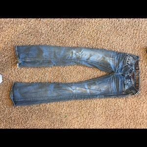 Women's Distressed Rock Revival Jeans